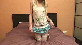 Petite blonde in stockings slowly unclothing